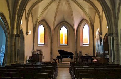 Concert piano setting in Church Of Scotland in Geneva